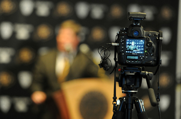 Mike MacIntyre is officially named the next football coach at the University of Colorado as seen through a video camera.<br /> Cliff Grassmick / December10, 2012
