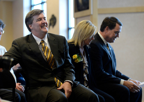 """University of Colorado head coach Mike MacIntyre, left, his wife Trisha, and Athletic Director Mike Bohn sit next to each other during a press conference in the club level of Folsom Field on Monday, Dec. 10, on the CU campus in Boulder. For more photos and video of the press conference go to  <a href=""""http://www.dailycamera.com"""">http://www.dailycamera.com</a><br /> Jeremy Papasso/ Camera"""