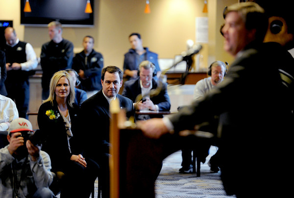 Trisha MacIntyre and Mike Bohn listen to Mike MacIntyre speak to the media.<br /> Mike MacIntyre is officially named the next football coach at the University of Colorado.<br /> Cliff Grassmick / December10, 2012