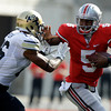 Ohio State's Braxton Miller, right, runs with pressure from Colorado's Ray Polk during the second quarter of an NCAA college football game Saturday, Sept. 24, 2011, in Columbus, Ohio. Ohio State defeated Colorado 37-17. (AP Photo/Jay LaPrete)