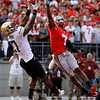 Colorado's Toney Clemons, left, catches a touchdown pass as Ohio State's Travis Howard defends during the second quarter of an NCAA college football game Saturday, Sept. 24, 2011, in Columbus, Ohio. (AP Photo/Jay LaPrete)