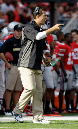 Ohio State's Luke Fickell coaches during the second quarter of an NCAA college football game against Colorado Saturday, Sept. 24, 2011, in Columbus, Ohio. (AP Photo/Jay LaPrete)