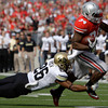 Colorado's Ray Polk, left, tackles Ohio State's Carlos Hyde during the first quarter of an NCAA college football game Saturday, Sept. 24, 2011, in Columbus, Ohio. (AP Photo/Jay LaPrete)