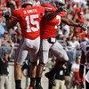 Ohio State's Devin Smith, left, and Jordan Hall celebrate Smith's touchdown during the second quarter of an NCAA college football game against Colorado Saturday, Sept. 24, 2011, in Columbus, Ohio. (AP Photo/Jay LaPrete)