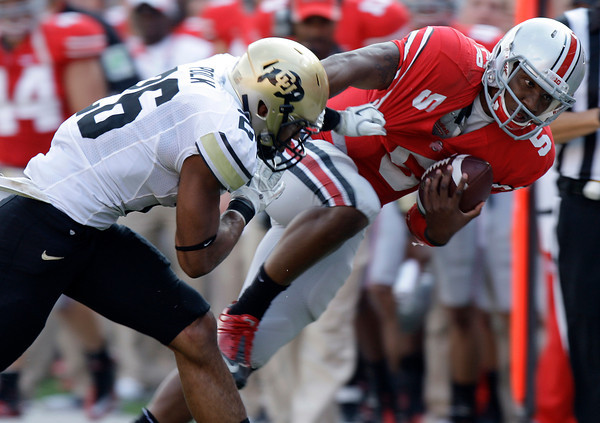 Ohio State's Braxton Miller, right, is forced out of bounds by Colorado's Ray Polk during the second quarter of an NCAA college football game Saturday, Sept. 24, 2011, in Columbus, Ohio. (AP Photo/Jay LaPrete)