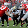 Colorado's Rodney Stewart, center, runs the ball between Ohio State's Garrett Goebel, left, and Storm Klein during the third quarter of an NCAA college football game Saturday, Sept. 24, 2011, in Columbus, Ohio. Ohio State defeated Colorado 37-17. (AP Photo/Jay LaPrete)