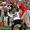 Colorado's Greg Henderson, left, breaks up a pass intended for Ohio State's Devin Smith during the first quarter of an NCAA college football game Saturday, Sept. 24, 2011, in Columbus, Ohio. (AP Photo/Jay LaPrete)