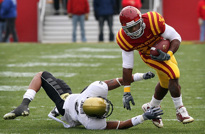 Iowa State's Alexander Robinson, right, breaks a tackle by Colorado's Jimmy Smith, left, during the first quarter of an NCAA college football game, Saturday, Nov. 14, 2009, in Ames, Iowa. (AP Photo/Charlie Neibergall)