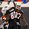 Oklahoma State wide receiver Justin Blackmon, left, celebrates a touchdown against Colorado with teammate Tracy Moore, right, in the fourth quarter of an NCAA college football game in Stillwater, Okla., Thursday, Nov. 19, 2009. Oklahoma State won the game 31-28. (AP Photo/Sue Ogrocki)