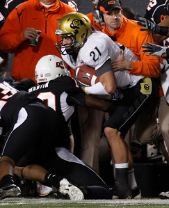 Colorado wide receiver Scotty McKnight, right, is pushed out of bounds by Oklahoma State's Markelle Martin, left, in the third quarter of an NCAA college football game in Stillwater, Okla., Thursday, Nov. 19, 2009. Oklahoma State won the game 31-28. (AP Photo/Sue Ogrocki)