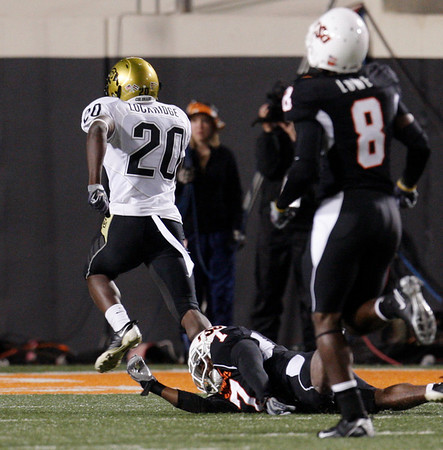 Colorado's Brian Lockridge, left, returns a kickoff 98-yards for a touchdown against Oklahoma State in the fourth quarter of an NCAA college football game in Stillwater, Okla., Thursday, Nov. 19, 2009. Oklahoma State won the game 31-28. (AP Photo/Sue Ogrocki)
