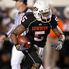 Oklahoma State running back Keith Toston takes a pass 47-yards for a touchdown against Colorado in the fourth quarter of an NCAA college football game in Stillwater, Okla., Thursday, Nov. 19, 2009. Oklahoma State won the game 31-28. (AP Photo/Sue Ogrocki)
