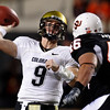 Colorado quarterback Tyler Hansen passes under pressure from Oklahoma State defender Shane Jarka, right, in the third quarter of an NCAA college football game in Stillwater, Okla., Thursday, Nov. 19, 2009. Oklahoma State won 31-28. (AP Photo/Sue Ogrocki)
