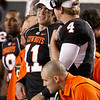 Injured Oklahoma State quarterback Zac Robinson (11) talks with reserve quarterback Brandon Weeden (4) in the first quarter of an NCAA college football game against Colorado in Stillwater, Okla., Thursday, Nov. 19, 2009. (AP Photo/Sue Ogrocki)
