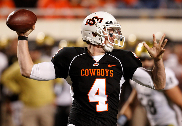 Oklahoma State's Alex Cate passes against Colorado in the third quarter of an NCAA college football game in Stillwater, Okla., Thursday, Nov. 19, 2009. Oklahoma State won the game 31-28. (AP Photo/Sue Ogrocki)