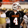 ** CORRECTS TO BRANDON WEEDEN FROM ALEX CATE ** Oklahoma State's Brandon Weeden passes against Colorado in the third quarter of an NCAA college football game in Stillwater, Okla., Thursday, Nov. 19, 2009. Oklahoma State won the game 31-28. (AP Photo/Sue Ogrocki)