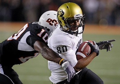 Colorado's Brian Lockridge, right, is tackled by Oklahoma State's Markelle Martin, left, in the second quarter of an NCAA college football game in Stillwater, Thursday, Okla., Nov. 19, 2009. (AP Photo/Sue Ogrocki)