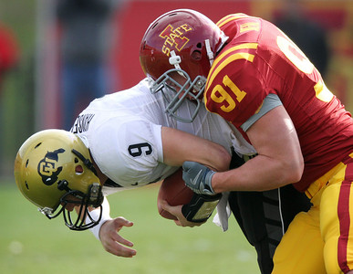 Colorado's Tyler Hansen (9) is sacked by Iowa State's Patrick Neal during the second quarter of an NCAA college football game, Saturday, Nov. 14, 2009, in Ames, Iowa. (AP Photo/Charlie Neibergall)