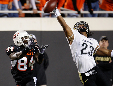 Colorado's Matt Meyer, right, breaks up a pass intended for Oklahoma State's Hubert Anyiam, left, in the first quarter of an NCAA college football game in Stillwater, Okla.,Thursday, Nov. 19, 2009. (AP Photo/Sue Ogrocki)