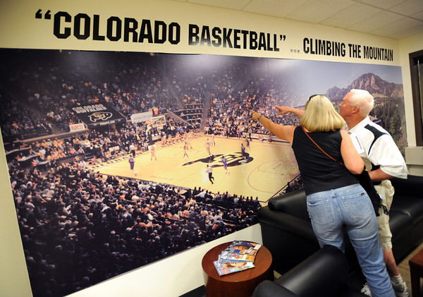 "Fans find themselves inside the Coors Events Center photo in Tad Boyle's office.<br /> The University of Colorado Athletic Department held the grand opening of the new practice facilities for volleyball and basketball on Saturday.<br /> For more photos of the new facility, go to  <a href=""http://www.dailycamera.com"">http://www.dailycamera.com</a><br /> Cliff Grassmick / August 20, 2011"
