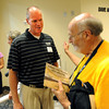 "Men's basketball coach, Tad Boyle, talks to retired announcer, Alan Cass, who can be a full-time fan now.<br /> The University of Colorado Athletic Department held the grand opening of the new practice facilities for volleyball and basketball on Saturday.<br /> For more photos of the new facility, go to  <a href=""http://www.dailycamera.com"">http://www.dailycamera.com</a><br /> Cliff Grassmick / August 20, 2011"