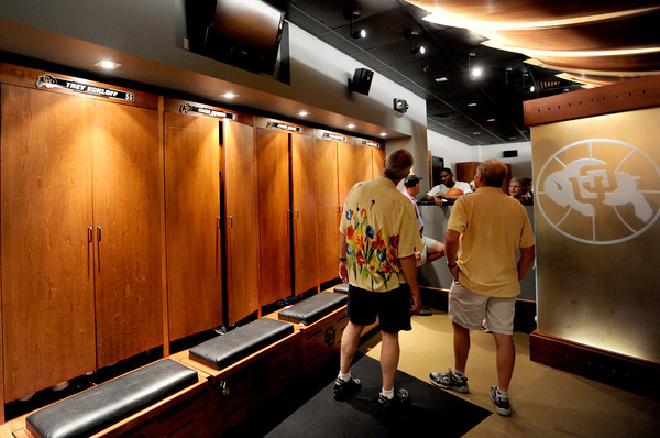 "Fans tour the men's locker room for basketball.<br /> The University of Colorado Athletic Department held the grand opening of the new practice facilities for volleyball and basketball on Saturday.<br /> For more photos of the new facility, go to  <a href=""http://www.dailycamera.com"">http://www.dailycamera.com</a><br /> Cliff Grassmick / August 20, 2011"