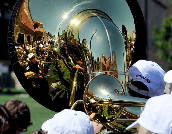 "The CU marching band and the part of the new facility is reflected in the tuba.<br /> The University of Colorado Athletic Department held the grand opening of the new practice facilities for volleyball and basketball on Saturday.<br /> For more photos of the new facility, go to  <a href=""http://www.dailycamera.com"">http://www.dailycamera.com</a><br /> Cliff Grassmick / August 20, 2011"