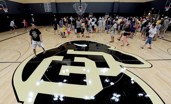 "Fans get a look at the upper practice gym.<br /> The University of Colorado Athletic Department held the grand opening of the new practice facilities for volleyball and basketball on Saturday.<br /> For more photos of the new facility, go to  <a href=""http://www.dailycamera.com"">http://www.dailycamera.com</a><br /> Cliff Grassmick / August 20, 2011"