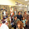 "Fans walk past photos of past and present stars of the women's program.<br /> The University of Colorado Athletic Department held the grand opening of the new practice facilities for volleyball and basketball on Saturday.<br /> For more photos of the new facility, go to  <a href=""http://www.dailycamera.com"">http://www.dailycamera.com</a><br /> Cliff Grassmick / August 20, 2011"