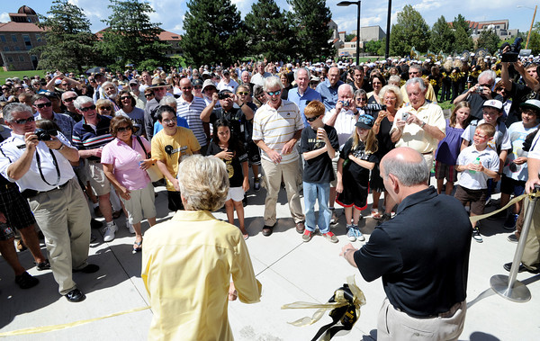 """Ceal Barry, left, and Phil DiStefano, cut the ribbon to open the new facility.<br /> The University of Colorado Athletic Department held the grand opening of the new practice facilities for volleyball and basketball on Saturday.<br /> For more photos of the new facility, go to  <a href=""""http://www.dailycamera.com"""">http://www.dailycamera.com</a><br /> Cliff Grassmick / August 20, 2011"""