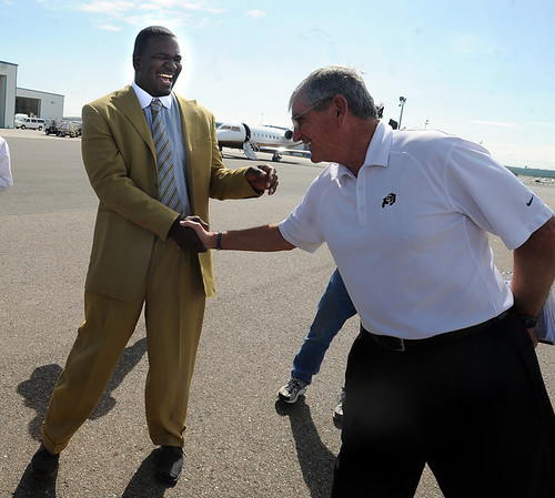 "Former CU player Alfred Williams, left, and his coach, Bill McCartney, appear to be happy to see each other.<br /> Pac-10 Commissioner Larry Scott and staff came to Boulder on Friday to meet the CU Regents and  officially sign the Pac-10 documents with the University of Colorado.<br /> For more photos and videos, go to  <a href=""http://www.dailycamera.com"">http://www.dailycamera.com</a>.<br /> Cliff Grassmick / June 11, 2010"
