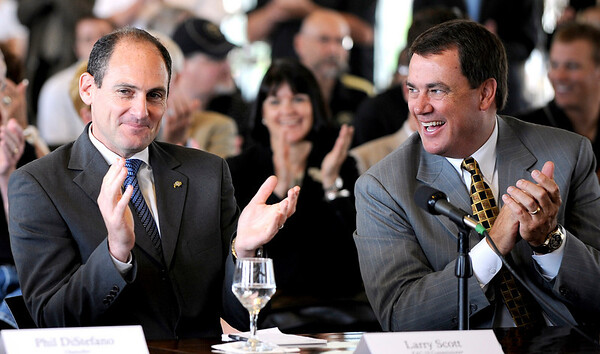 0611PAC3.jpg PAC 10 Commissioner Larry Scott (cq)(left) and CU Athletic Director Mike Bohn (cq)(right) clap after the Board of Regents unanimously votes to move the University of Colorado into the PAC 10 in Boulder, Colorado June 11, 2010.  CAMERA/Mark Leffingwell