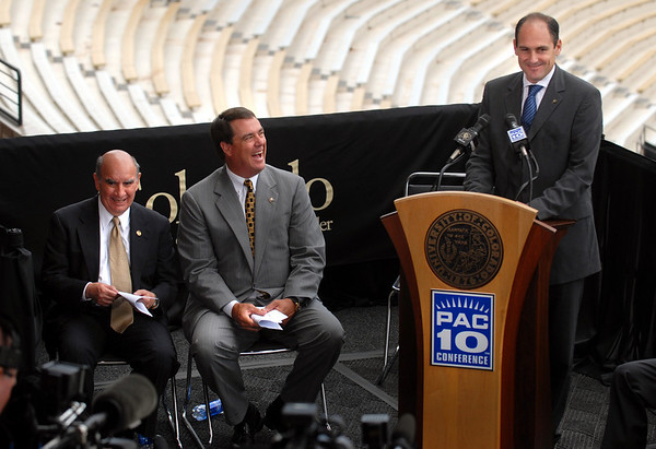 "Pac-10 Commissioner, Larry Scott addresses the media in Folsom Field. Chancellor Phil DiStephano, left, and CU Athletic Director, Mike Bohn, laugh at one of his comments.<br /> Pac-10 Commissioner Larry Scott and staff came to Boulder on Friday to meet the CU Regents and  officially sign the Pac-10 documents with the University of Colorado.<br /> For more photos and videos, go to  <a href=""http://www.dailycamera.com"">http://www.dailycamera.com</a>.<br /> Cliff Grassmick / June 11, 2010"