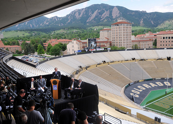 """Pac-10 Commissioner, Larry Scott addresses the media in Folsom Field.<br /> Pac-10 Commissioner Larry Scott and staff came to Boulder on Friday to meet the CU Regents and  officially sign the Pac-10 documents with the University of Colorado.<br /> For more photos and videos, go to  <a href=""""http://www.dailycamera.com"""">http://www.dailycamera.com</a>.<br /> Cliff Grassmick / June 11, 2010"""