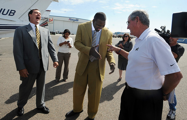 "Mike Bohn, left, gets a laugh out of former CU Player Alfred Williams and former coach, Bill McCartney.<br /> Pac-10 Commissioner Larry Scott and staff came to Boulder on Friday to meet the CU Regents and  officially sign the Pac-10 documents with the University of Colorado.<br /> For more photos and videos, go to  <a href=""http://www.dailycamera.com"">http://www.dailycamera.com</a>.<br /> Cliff Grassmick / June 11, 2010"