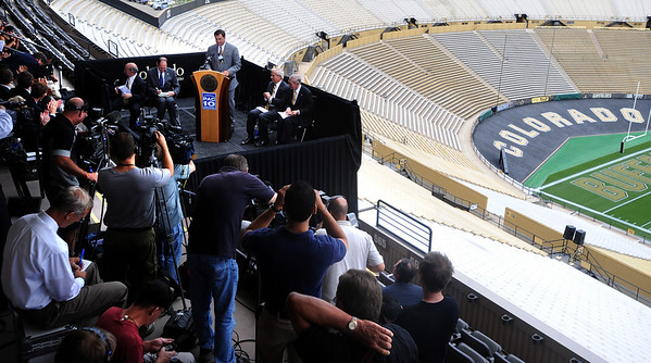 "Colorado Athletic Director, Mike Bohn, addresses the media in Folsom Field.<br /> Pac-10 Commissioner Larry Scott and staff came to Boulder on Friday to meet the CU Regents and  officially sign the Pac-10 documents with the University of Colorado.<br /> For more photos and videos, go to  <a href=""http://www.dailycamera.com"">http://www.dailycamera.com</a>.<br /> Cliff Grassmick / June 11, 2010"