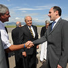 "Former CU football coach, Bill McCartney, left, shakes the hand of Larry Scott as CU President Bruce Benson looks on.<br /> Pac-10 Commissioner Larry Scott and staff came to Boulder on Friday to meet the CU Regents and  officially sign the Pac-10 documents with the University of Colorado.<br /> For more photos and videos, go to  <a href=""http://www.dailycamera.com"">http://www.dailycamera.com</a>.<br /> Cliff Grassmick / June 11, 2010"