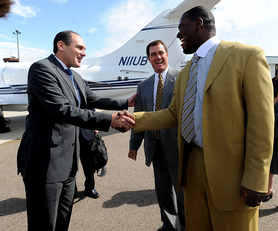 "Pac-10 Commissioner Larry Scott, left, is greeted at the Rocky Mountain Regional airport in Broomfield by CU AD Mike Bohn, center,  and former CU player, Alfred Williams.<br /> Pac-10 Commissioner Larry Scott and staff came to Boulder on Friday to meet the CU Regents and  officially sign the Pac-10 documents with the University of Colorado.<br /> For more photos and videos, go to  <a href=""http://www.dailycamera.com"">http://www.dailycamera.com</a>.<br /> Cliff Grassmick / June 11, 2010"