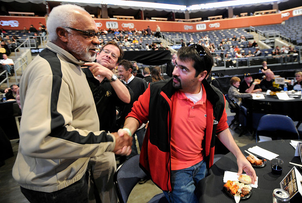 """Former University of Colorado football player Bill Harris, left, shakes hands with Agustin Figallo during the Parade Of Buffs on Thursday, Sept. 27, at the First Bank Center in Broomfield. For more photos of the event go to  <a href=""""http://www.dailycamera.com"""">http://www.dailycamera.com</a><br /> Jeremy Papasso/ Camera"""