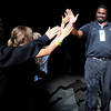 "University of Colorado defensive line coach Kanavis McGhee high-fives fans during the Parade Of Buffs on Thursday, Sept. 27, at the First Bank Center in Broomfield. For more photos of the event go to  <a href=""http://www.dailycamera.com"">http://www.dailycamera.com</a><br /> Jeremy Papasso/ Camera"