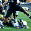 CU's Marcus Burton (54) jumps over CSU's John Mosure (7) after he releases the ball at the annual Rocky Mountain Showdown in Folsom Field in Boulder, Colorado on Sunday, Sept. 6, 2009.<br /> KASIA BROUSSALIAN / THE CAMERA