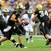 CU's COdy Hawkins (7) turns to give the ball to Darrell Scott (2) at the annual Rocky Mountain Showdown in Folsom Field in Boulder, Colorado on Sunday, Sept. 6, 2009.<br /> KASIA BROUSSALIAN / THE CAMERA