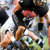 CU's Scotty McKnight (21) is taken down by CSU's Alex Williams (51) at the annual Rocky Mountain Showdown in Folsom Field in Boulder, Colorado on Sunday, Sept. 6, 2009.<br /> KASIA BROUSSALIAN / THE CAMERA
