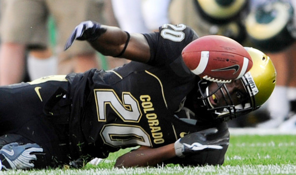 CU's Brian Lockridge (20) loses grasp of the ball at the annual Rocky Mountain Showdown in Folsom Field in Boulder, Colorado on Sunday, Sept. 6, 2009.<br /> KASIA BROUSSALIAN / THE CAMERA