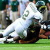 CU's Jason Espinoza (15) falls to the ground after being tackled by CSU's DeAngelo Wilkinson (2) at the annual Rocky Mountain Showdown in Folsom Field in Boulder, Colorado on Sunday, Sept. 6, 2009.<br /> KASIA BROUSSALIAN / THE CAMERA