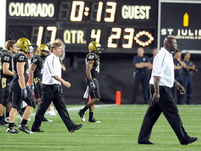 Dan Hawkins and the Buffs go to congratulate CSU on the win. Cliff Grassmick / September 6, 2009