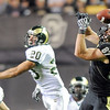 Riar Geer of CU misses the catch with Klint Kubiak of CSU defending.<br /> Cliff Grassmick / September 6, 2009