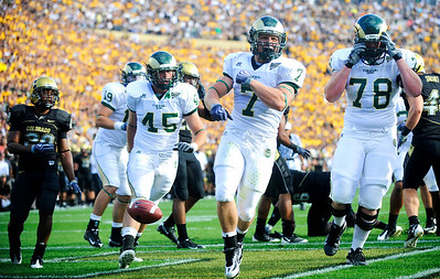 CSU's John Mosure (7), Mark Starr (78), and Marcus Shaw (15) celebrate after a touchdown during the first half of the game at the annual Rocky Mountain Showdown in Folsom Field in Boulder, Colorado on Sunday, Sept. 6, 2009. KASIA BROUSSALIAN / THE CAMERA