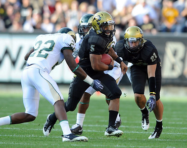 Rodney Stewart of CU tries to get past  Elijah-Blu Smith of CSU. Cliff Grassmick / September 6, 2009