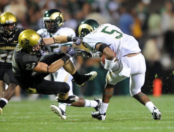 Arthur Jaffee of CU tries to wrap up Gerard Thomas of CSU.<br /> Cliff Grassmick / September 6, 2009